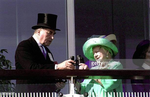 The Queen Mother At The Derby With The Queen's Racing Manager Lord Carnarvon Sharing Binoculars
