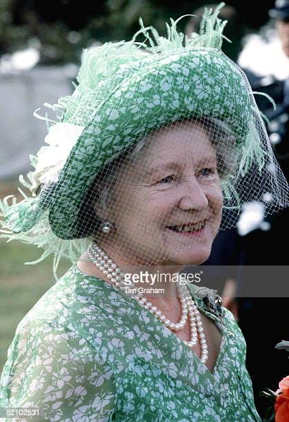 The Queen Mother Attending The Sandringham Flower Show She Is Wearing A Green And White Floral Print Dress With A Matching Hat Decorated With Pale...