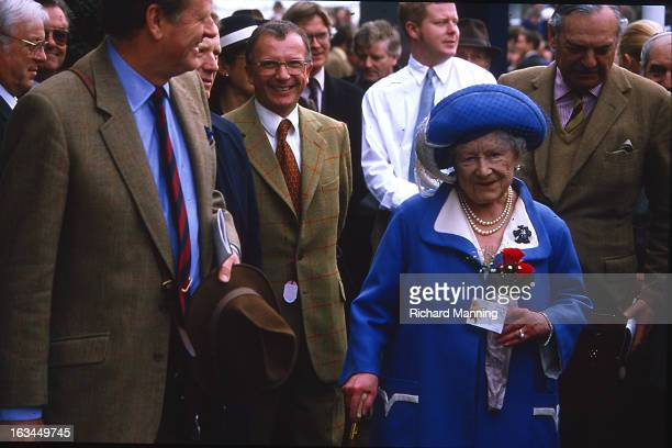 The Queen Mother attends the Grand Military Gold Cup accompanied by Peter ParkerBowles Held annually at Sandown Park Racecourse in Esher Surrey it is...