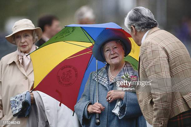 The Queen Mother carrying a small bouquet of flowers and a multicoloured umbrella in Scrabster Harbour Scrabster Scotland Great Britain 15 August...