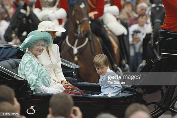 The Queen Mother Diana Princess of Wales and Prince William riding in a horsedrawn carriage at the Trooping the Colour ceremony in London England...