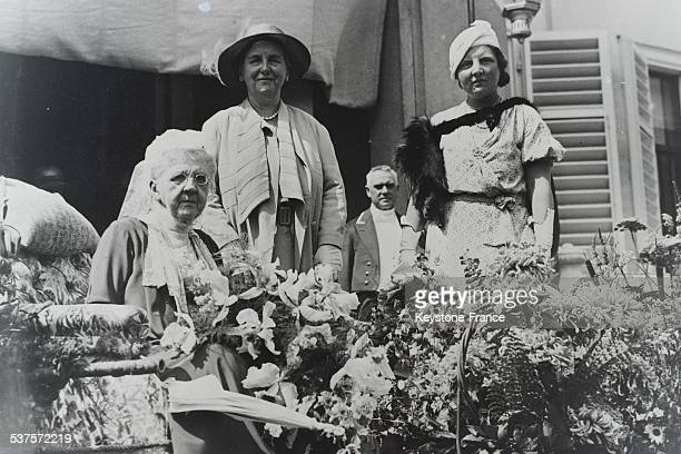 The queen mother Emma of the Netherlands celebrates her birthday surrounded by her daughter Queen Wilhelmina and her granddaughter Princess Juliana...
