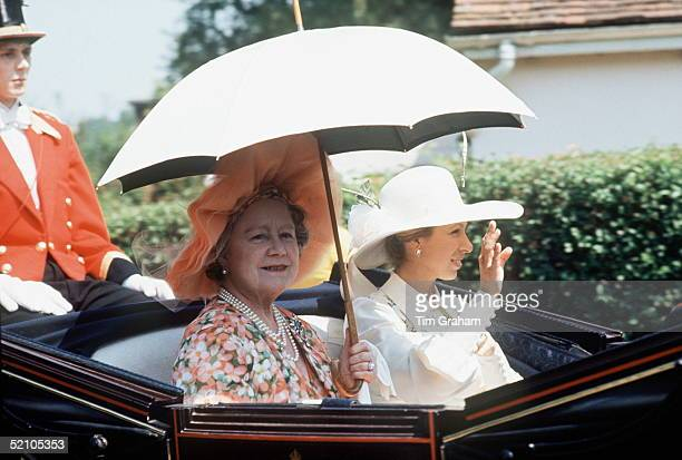 The Queen Mother Holding A White Parasol Sun Umbrella To Keep The Sun Off As She Arrives In An Open Carriage With Princess Anne To Watch The Racing...