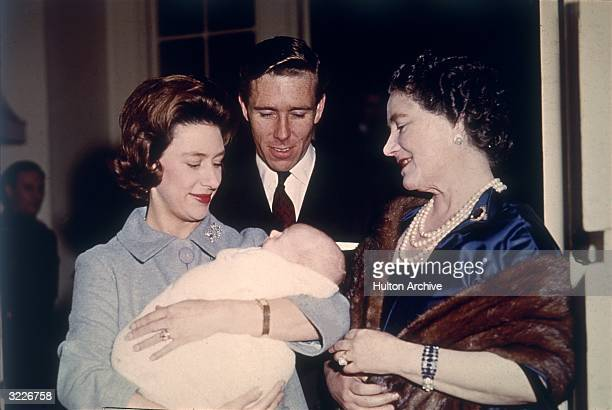 The Queen Mother is introduced to baby David Linley by his proud parents Princess Margaret and Lord Snowdon