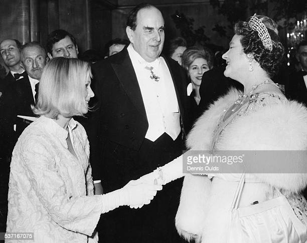 The Queen Mother meeting actors Ingrid Thulin and Robert Morley, at the 1965 Royal Film Performance, at the Odeon Theatre, London, February 15th 1965.