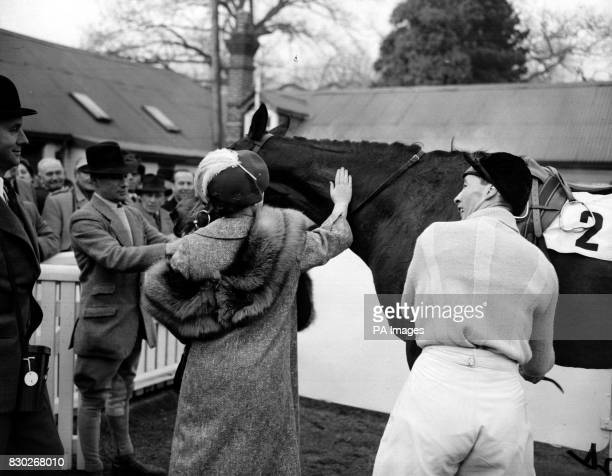 The Queen Mother pats her horse Devon Loch as jockey Dick Francis dismounts after winning the Blindley Heath Handicap Steeplechase at Lingfield Park