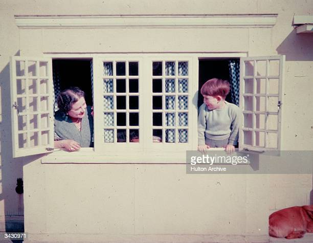 The Queen Mother playing with her grandson Prince Charles in the Little Welsh House at the Royal Lodge Windsor