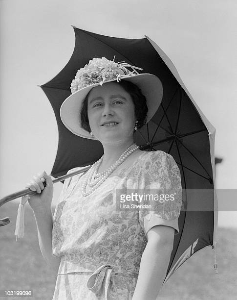The Queen Mother poses with an umbrella at Windsor Castle, England on July 8, 1941.