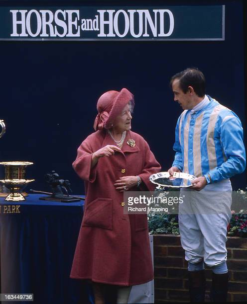 The Queen Mother presents a prize to the winning jockey Major Ollie Ellwood who rode Norman Conquest to victory in her racing colours at the annually...
