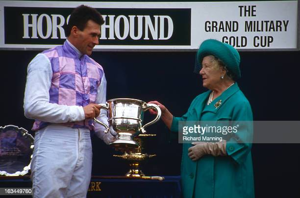 The Queen Mother presents a trophy at the annual Grand Military meeting at Sandown Park Racecourse in Esher Surrey It is a meeting point for the...