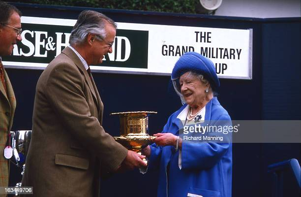 The Queen Mother presents the Grand Military Gold Cup Held annually at Sandown Park Racecourse in Esher Surrey it is a meeting point for the Military...