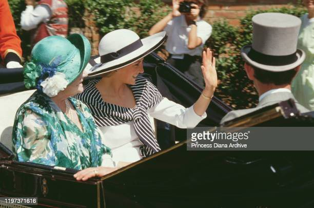 The Queen Mother , Prince Charles and Diana, Princess of Wales at the Royal Ascot race meeting, UK, June 1988. Diana is wearing a white suit with a...