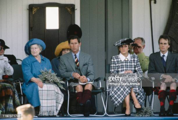 The Queen Mother, Prince Charles and Diana, Princess of Wales at the Braemar Games, a Highland Games Gathering in Braemar, Scotland, September 1989....