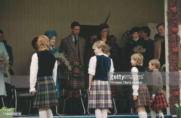 The Queen Mother, Prince Charles and Diana, Princess of Wales attend the Braemar Games, an annual Highland Games Gathering at Braemar in Scotland,...