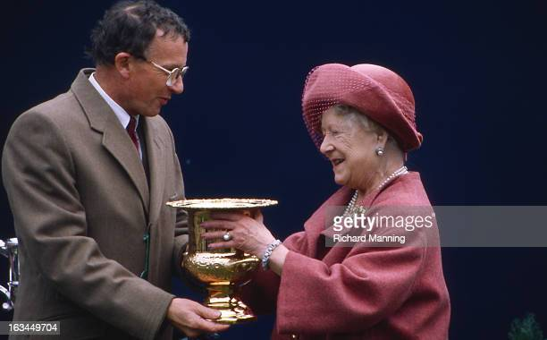 The Queen Mother receives the Grand Military Gold Cup at the annually held Military meeting at Sandown Park Racecourse in Esher Surrey It is a...