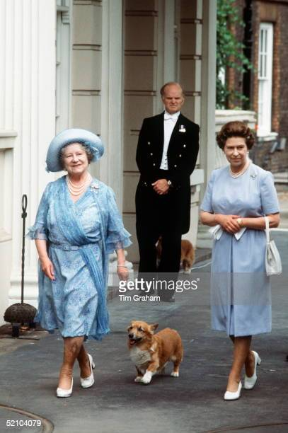 The Queen Mother, Smiling, With Her Daughter, Queen Elizabeth Ll, Outside Clarence House With Her Pet Corgi On Her 83rd Birthday. The Queen Mother Is...