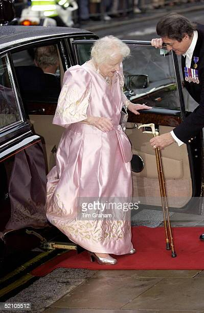 The Queen Mother Stepping Carefully From Her Official Car Onto The Red Carpet While Arriving At The Royal Opera House In Covent Garden On Her 101st...