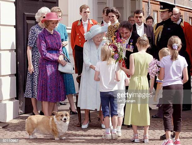 The Queen Mother Surrounded By Her Staff Meeting Children At Clarence House In London For Her 101st Birthday Her Corgi Came Too