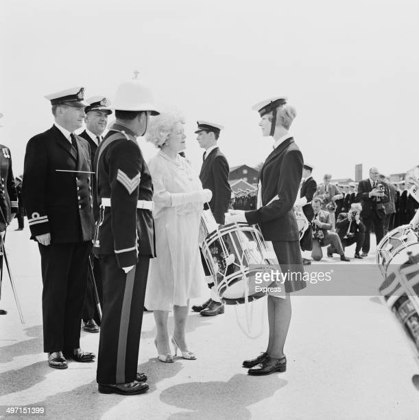 The Queen Mother talking to Dorothy Stewart of the Women's Royal Naval Service at HMS Collingwood a shore establishment of the Royal Navy near...