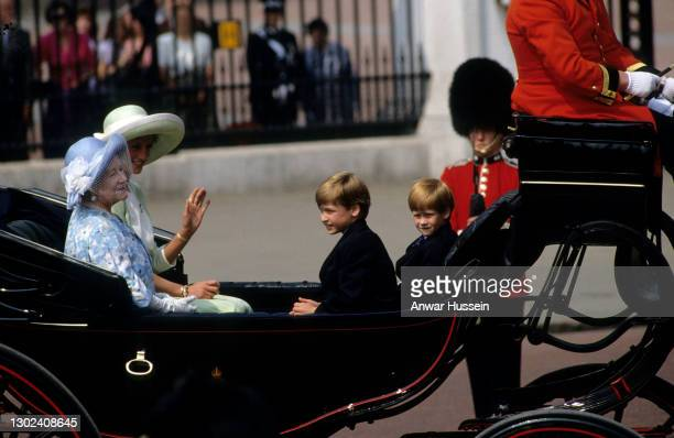 The Queen Mother, the Princess of Wales and her children, Prince William and Prince Harry ride back to Buckingham Palace following the Trooping of...