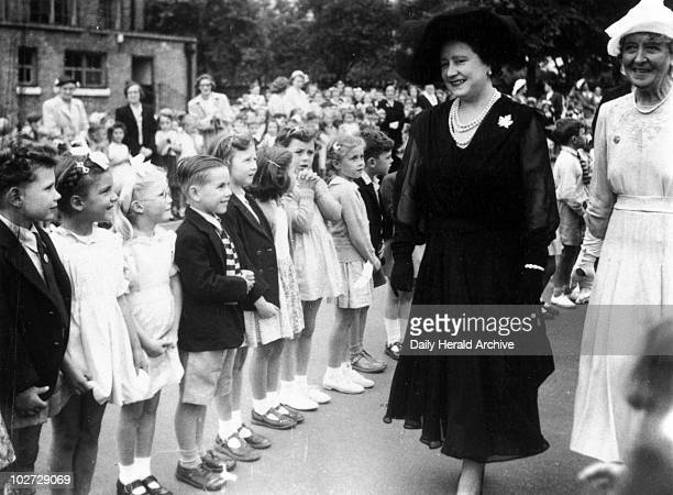 """The Queen Mother visiting Peterborough School, Fulham, London, 17 July 1952."""" 'The Queen Mother paid a visit to the Peterborough School, Fulham, and..."""