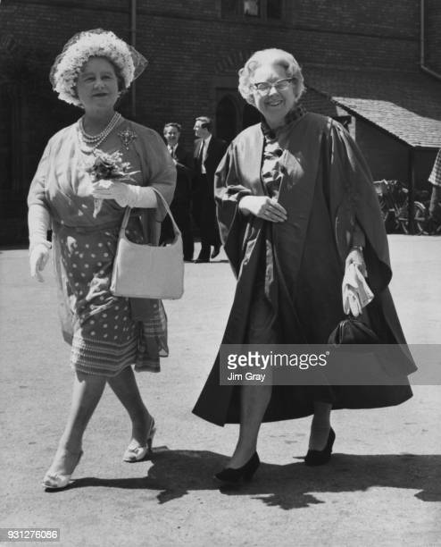 The Queen Mother walks with Professor Muriel Bradbrook the Mistress of Girton College Cambridge during a visit to the college to mark the centenary...