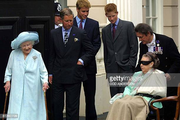 The Queen Mother watches her youngest daughter Princess Margaret being wheeled out by stewart William Tallon as her grandson Prince Charles and...