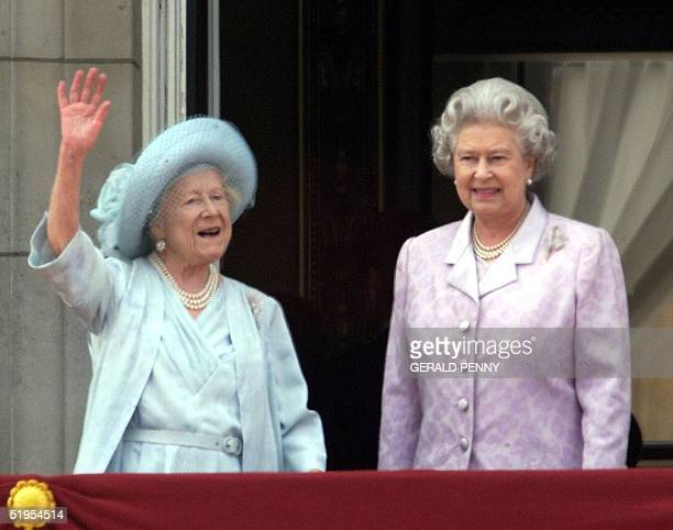 The Queen Mother waves along side Queen Elizabeth II on the balcony of Buckingham Palace on her 100th birthday 04 August 2000 The Queen Mother...