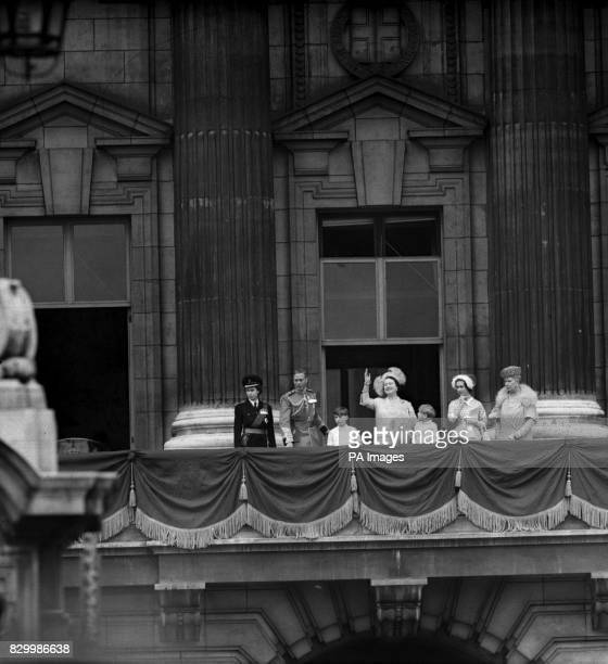 The Queen Mother waves and other members of the Royal family gather on the balcony of Buckingham Palace after the Trooping of the Colour at Horse...