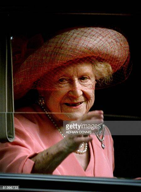 The Queen Mother waves to the crowd from her car after attending a national service of thanksgiving in celebration of her forthcoming 100th birthday...