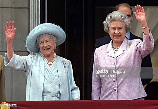 The Queen Mother waves to the people along side Queen Elizabeth II on the balcony of Buckingham Palace on her 100th birthday 04 August 2000 The Queen...