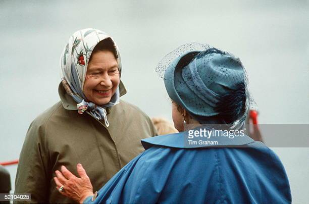 The Queen Mother Welcoming Her Daughter, Queen Elizabeth Ll, On Her Arrival For Her Annual Summer Holiday Visit. They Are Both Wearing Raincoats And...