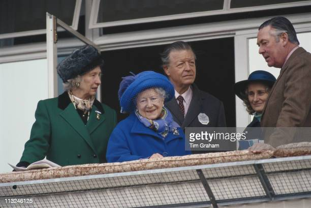 The Queen Mother , with Michael Oswald, manager of the Royal Stud, and Samuel Vestey, 3rd Baron Vestey, of the Dewhurst meat chain, at Cheltenham...