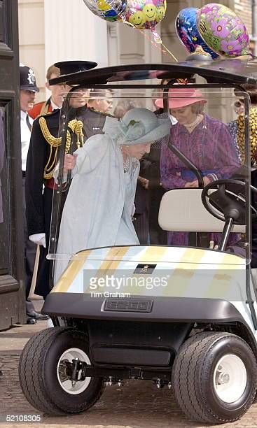 The Queen Mother's 101st Birthday At Clarence House London She Climbs Into Her Buggy Which Has Her Cypher On The Bonnet