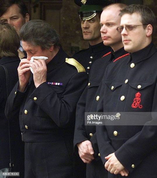 The Queen Mother's butler Billy Tallon weeps as the Queen Mother's coffin is carried by pall bearers into the Queen's Chapel at St James' palace