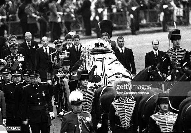 The Queen Mother's coffin being escorted to Westminster Abbey by Yeomen of the Guard and members of the royal family during the ceremonial procession...
