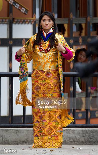 The Queen of Bhutan Ashi Jetsun Pema Wangchuck fixes her traditional Bhutanese Kira as she greets thousands of Bhutanese citizens at the celebration...