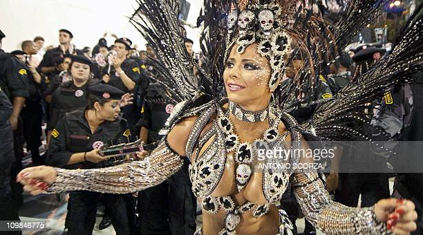 The Queen of Drums of Academicos do Salgueiro samba school Viviane Araujo performs at the Sambadrome during the second night of carnival parade in...