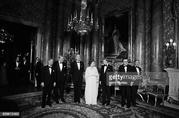 The Queen of England hosts a dinner at Buckingham Palace in honor of the of the seven heads of government who met in London to discuss the...