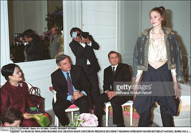 The queen of Thailand look at a haute couture creation besides Sidney Toledano and Michael Burke - queen of Thailand at Dior.