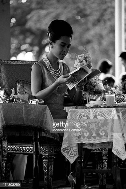 The Queen of Thailand Sirikit getting some presents from her subjects during a fashion show Bangkok 1965