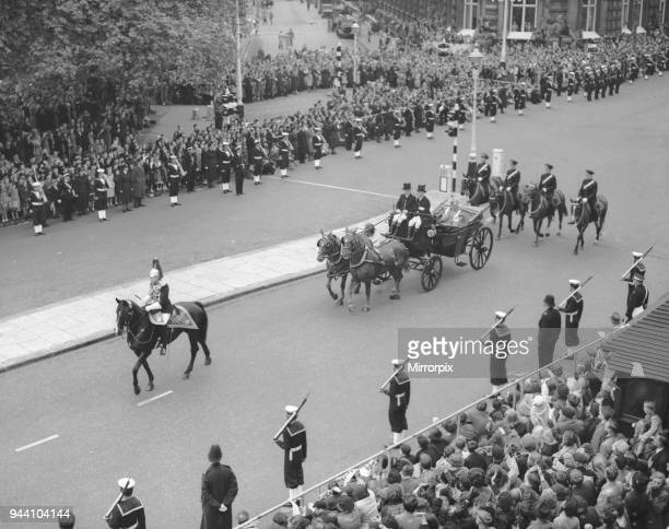 The Queen of Tonga waves to the crowds in Northumberland Avenue escorted by mounted members of the military police As she makes her way to...