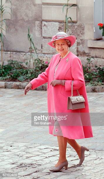 The Queen On A Visit To Blois In France Wearing A Pink And Taupe Outfit Designed By Fashion Designer Ian Thomas With Colour Coordinated Taupe Shoes...