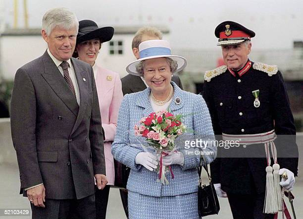 The Queen On The Isle Of Arran Scotland With Her Bodyguard Peter Prentice And Ladyinwaiting Susan Hussey And The Lord Lieutenant Of The County