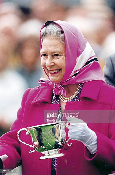 The Queen Presenting Prizes At Queen's Cup Polo, Windsor. She Is Holding A Cup In Her Hand.