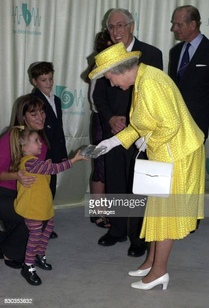 The Queen Receives a bionic ear in perspex from Claudia Danese at the Bionic Ear Institute in Melbourne A large crowd gathered outside the institute...