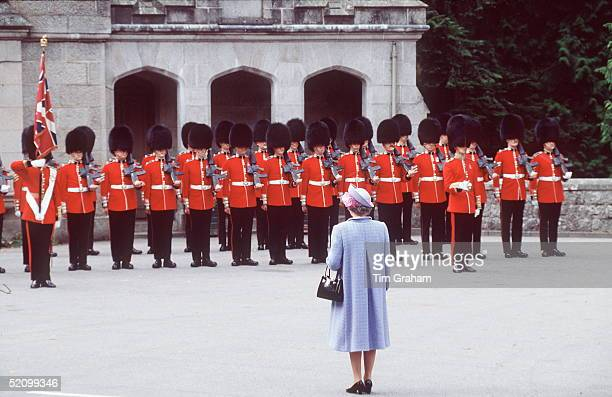 The Queen Reviewing The Guards At Balmoral Castle