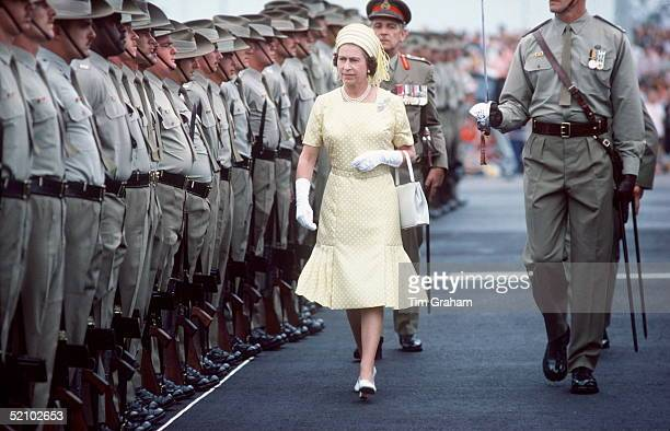 The Queen Reviewing Troops On Her Arrival In Brisbane, Australia During Her Jubilee Tour In February & March 1977
