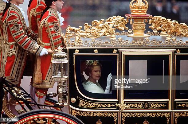 The Queen Riding In A Carriage On Her Way To The State Opening Of Parliament