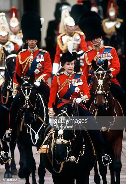 The Queen Riding Sidesaddle During The Trooping The Colour Ceremony Riding Behind Are Prince Philip And Prince Charles